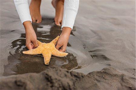 preteen girl feet - Young girl enjoying day at beach. Stock Photo - Premium Royalty-Free, Code: 6128-08747769
