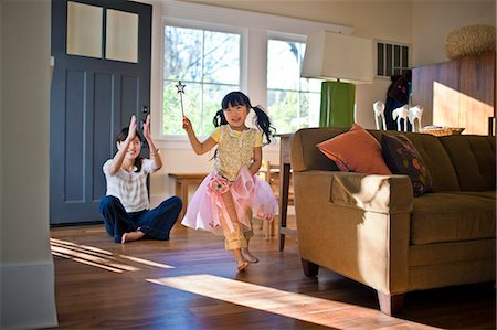 dress - Young girl in a fairy costume playing with her mother. Stock Photo - Premium Royalty-Free, Code: 6128-08747737