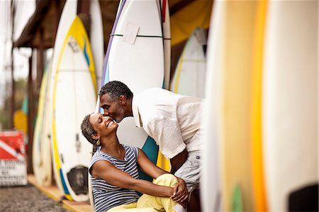 Loving couple at surfshop. Stock Photo - Premium Royalty-Free, Code: 6128-08748058