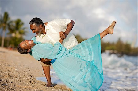 Happy mature couple dancing on the beach. Stock Photo - Premium Royalty-Free, Code: 6128-08748093