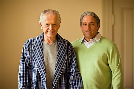 Senior man in his bathrobe and his mature son pose for a portrait. Stock Photo - Premium Royalty-Free, Code: 6128-08766982