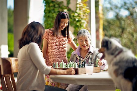 Smiling young girl spending time with her mother and grandmother. Stock Photo - Premium Royalty-Free, Code: 6128-08767201