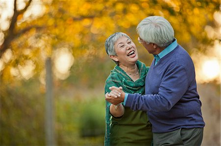 Happy senior couple playfully dancing together. Stock Photo - Premium Royalty-Free, Code: 6128-08767210