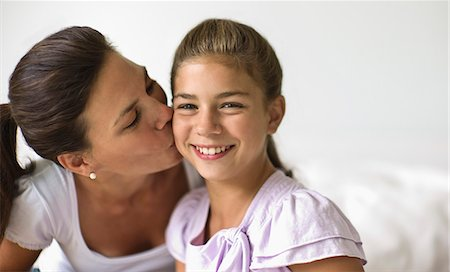 Portrait of woman at home with her daughter. Stock Photo - Premium Royalty-Free, Code: 6128-08780686
