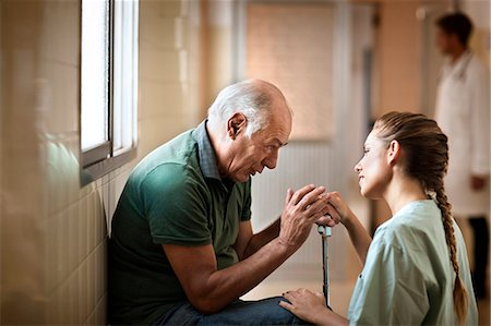 Senior man receiving bad news from a nurse. Stock Photo - Premium Royalty-Free, Code: 6128-08780761