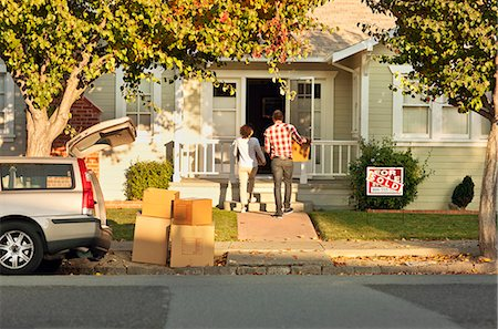Couple arrive with boxes at their new home. Stock Photo - Premium Royalty-Free, Code: 6128-08781050