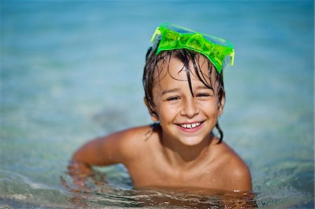 preteen boy shirtless - Portrait of a smiling young boy in a swimming pool. Stock Photo - Premium Royalty-Free, Code: 6128-08798819