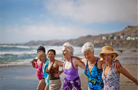 seniors woman in swimsuit - Happy mature friends enjoying a day at the beach. Stock Photo - Premium Royalty-Free, Code: 6128-08798954