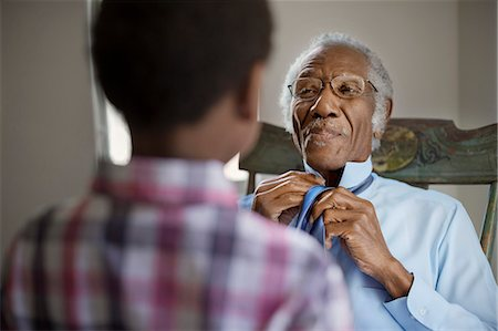 Grandfather tying necktie Stock Photo - Premium Royalty-Free, Code: 6128-08727778