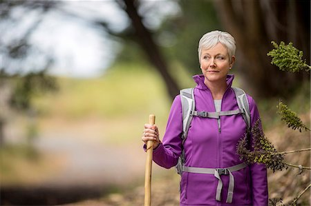 stick - Portrait of a mature woman enjoying a peaceful hike along a forest trail. Stock Photo - Premium Royalty-Free, Code: 6128-08728014