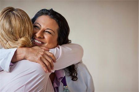 Doctor hugging patient who has received good news. Stock Photo - Premium Royalty-Free, Code: 6128-08728244