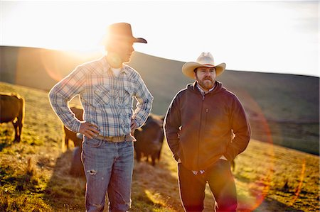 Two farmers standing on a paddock. Stock Photo - Premium Royalty-Free, Code: 6128-08737559