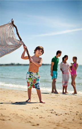 preteen boy shirtless - Young boy waves flag at beach. Stock Photo - Premium Royalty-Free, Code: 6128-08737740