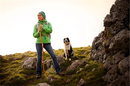 Confident mature woman out for a hike with her dog. Stock Photo - Premium Royalty-Free, Code: 6128-08738357