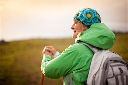Confident mature woman hiking in the countryside. Stock Photo - Premium Royalty-Free, Code: 6128-08738355
