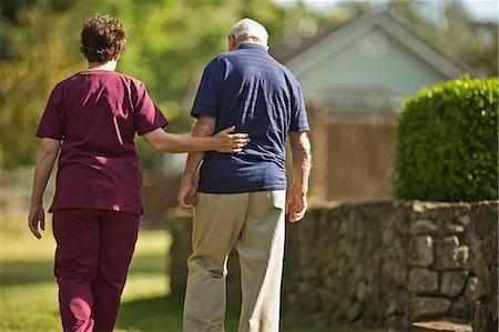 Mature nurse walking with a senior patient. Stock Photo - Premium Royalty-Free, Code: 6128-08738393