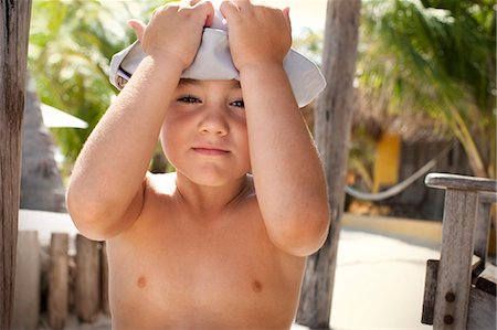 preteen boy shirtless - Portrait of a moody young boy. Stock Photo - Premium Royalty-Free, Code: 6128-08841038