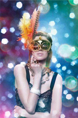 woman wearing a golden mask in a party Stock Photo - Premium Royalty-Free, Code: 613-07067979