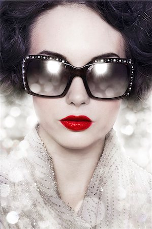 woman with bright red lips and sparkly shades Stock Photo - Premium Royalty-Free, Code: 613-07067985