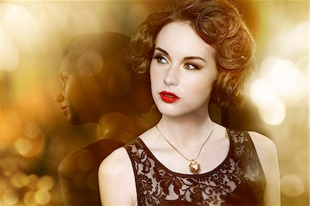 elegant - glamorous woman leaning against her own reflection Stock Photo - Premium Royalty-Free, Code: 613-07067988