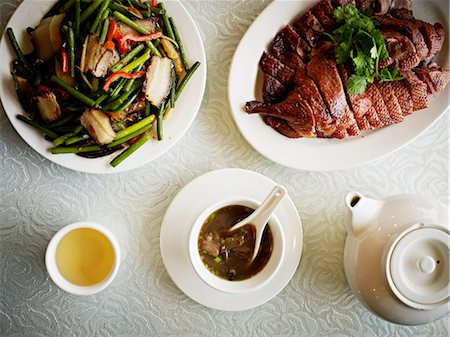 smoked - Overhead view of Chinese food and tea Stock Photo - Premium Royalty-Free, Code: 613-07454279