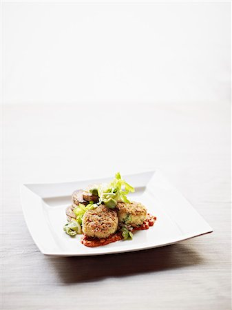 elegant - Dungeness crab cakes served with romesco sauce Stock Photo - Premium Royalty-Free, Code: 613-07454300