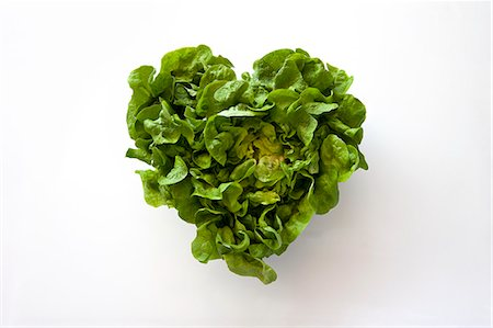 Heart-shaped formed by fresh Lettuce Stock Photo - Premium Royalty-Free, Code: 613-07454513