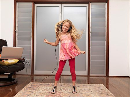 preteen dancing - Young girl at home dancing to music Stock Photo - Premium Royalty-Free, Code: 613-07454562