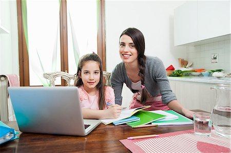 mum and daughter, laptop, homework, kitchen table Stock Photo - Premium Royalty-Free, Code: 613-07458815