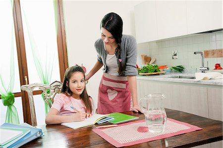 mum looking at children doing homework Stock Photo - Premium Royalty-Free, Code: 613-07458821