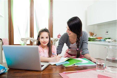 mum looking at daughter, laptop, homework, kitchen Stock Photo - Premium Royalty-Free, Code: 613-07458823