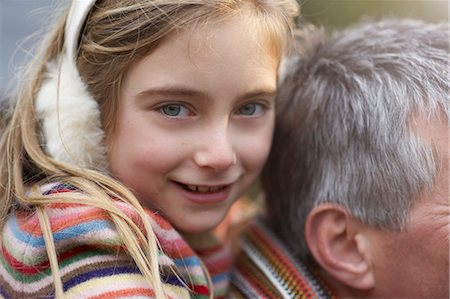 Close up of girl on fathers shoulders. Stock Photo - Premium Royalty-Free, Code: 613-07458928