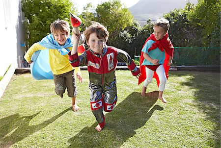superhero costume - Boys playing together in a garden Stock Photo - Premium Royalty-Free, Code: 613-07459159