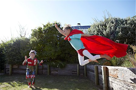 Boys playing at being superheroes Stock Photo - Premium Royalty-Free, Code: 613-07459164