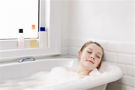 Woman relaxing at home in bubble bath Stock Photo - Premium Royalty-Free, Code: 613-07459189