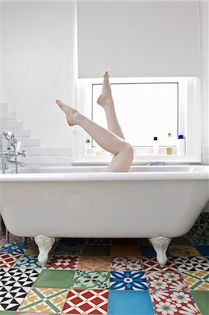 Woman in bath with her legs in the air Stock Photo - Premium Royalty-Free, Code: 613-07459199