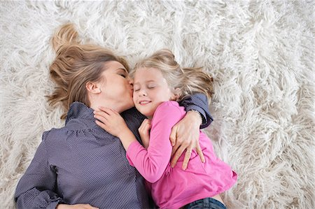 daughter kissing mother - Mother kissing daughter Stock Photo - Premium Royalty-Free, Code: 613-07459613