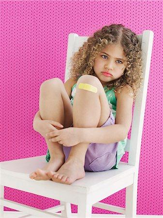 sad child sitting - Girl with Band-aid Stock Photo - Premium Royalty-Free, Code: 613-07492398