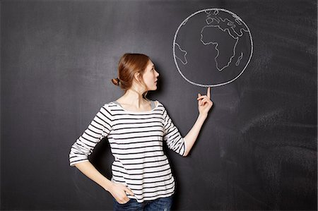 draw black women - Young woman balancing the world Stock Photo - Premium Royalty-Free, Code: 613-07492435