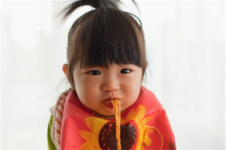The baby who eats spaghetti. Stock Photo - Premium Royalty-Free, Code: 613-07492526