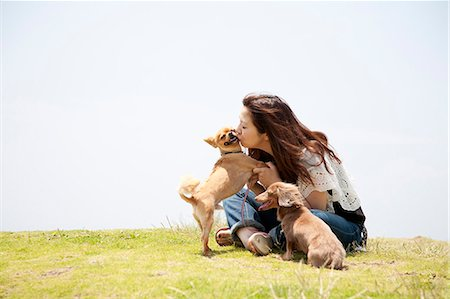 dog and woman and love - a woman with two dogs Stock Photo - Premium Royalty-Free, Code: 613-07492533