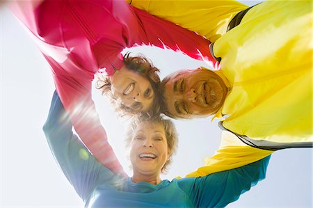 Three adults embracing Stock Photo - Premium Royalty-Free, Code: 613-07492563