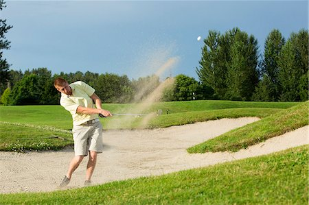 A man playing a round of golf. Stock Photo - Premium Royalty-Free, Code: 613-07492740