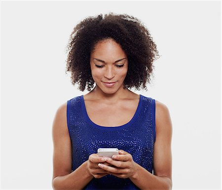 Woman with smart phone. Stock Photo - Premium Royalty-Free, Code: 613-07492762