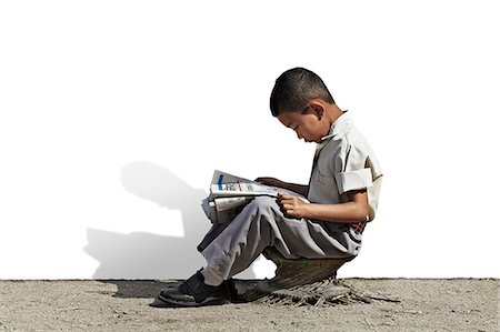 Young Nepali school boy reading newspaper Stock Photo - Premium Royalty-Free, Code: 613-07492786