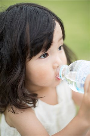Japanese girl drinking water portrait Stock Photo - Premium Royalty-Free, Code: 613-07492892
