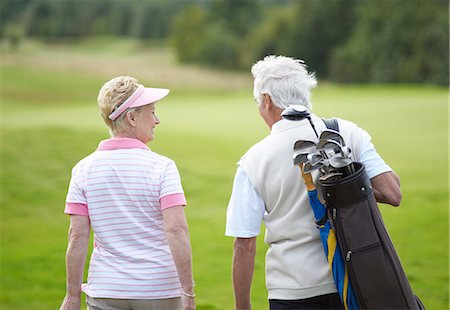 Senior golfers walking on course. Stock Photo - Premium Royalty-Free, Code: 613-07596935