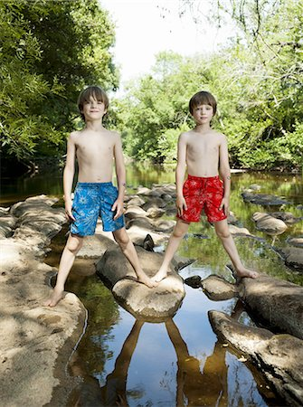 Two identical boys standing by the river Stock Photo - Premium Royalty-Free, Code: 613-07593400