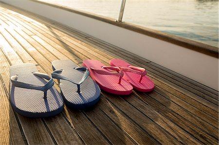 pair - Flip flops on teak deck of 62 ft sailboat Stock Photo - Premium Royalty-Free, Code: 613-07593437