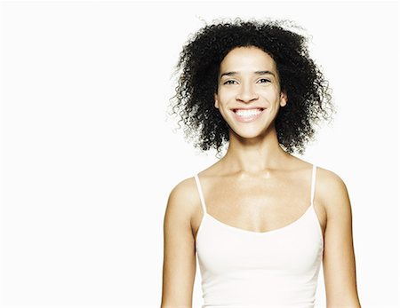 Portrait of woman smiling Stock Photo - Premium Royalty-Free, Code: 613-07673673